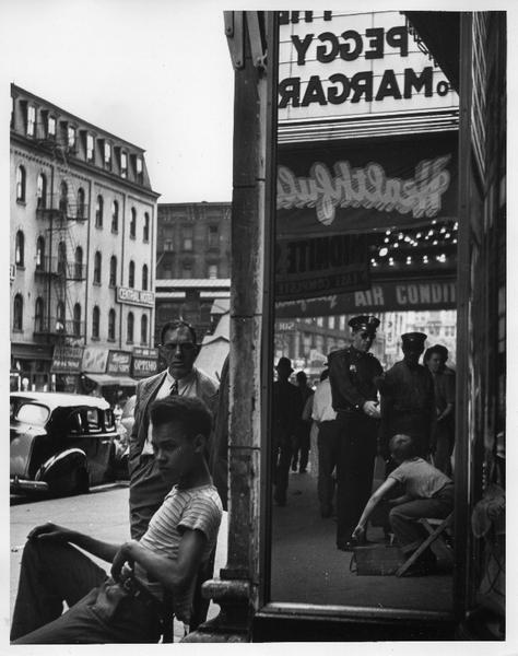Shoeshine Boy with cop,  14th Street, NYC, 1947